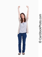 Smiling woman with arms risen