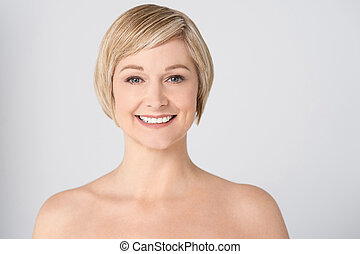 Topless middle aged woman posing to camera