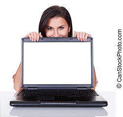 Smiling woman with blank laptop screen