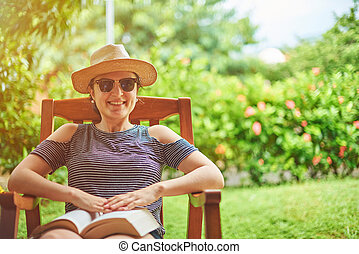 Smiling woman with book