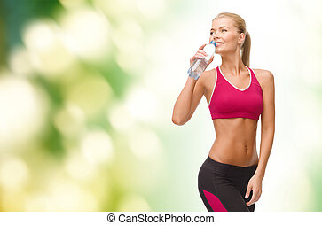 smiling woman with bottle of water - fitness, healthcare and...