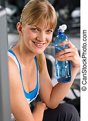 Smiling woman with bottle of water