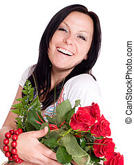 smiling woman with bouquet of roses