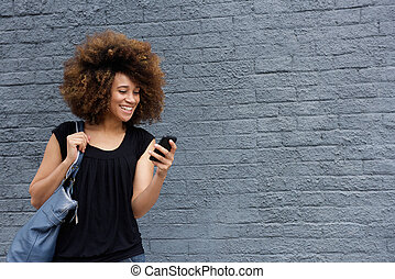 Smiling woman with cell phone