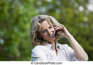 smiling woman with cellphone