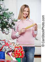 Smiling Woman With Christmas Gifts