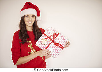 Smiling woman with Christmas present