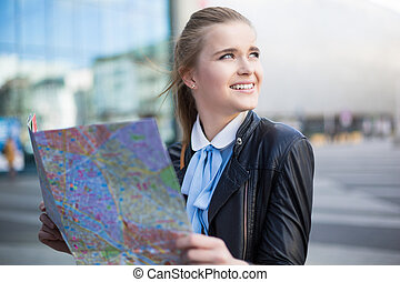 Smiling woman with city map in city