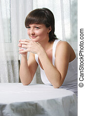 Smiling woman with cup