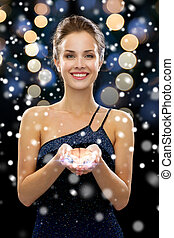 smiling woman with diamond - people, holidays and glamour...