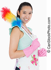 Smiling woman with duster