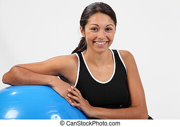 Smiling woman with exercise ball