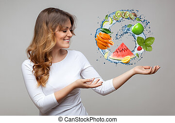 smiling woman with fruits and water splash on grey...