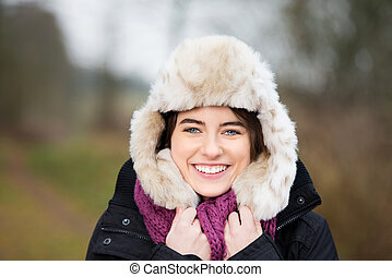 Smiling woman with fur hat