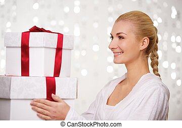 Smiling woman with gift boxes