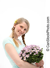 Smiling woman with gift of flowers
