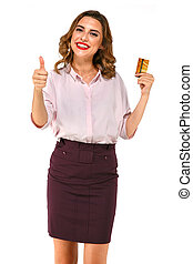 Smiling woman with gold credit card in hand shows thumb up