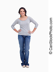 Smiling woman with hands on her hip