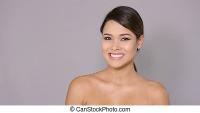 Smiling woman with happy sincere expression and her hand...