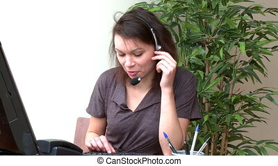 Smiling woman with headset on