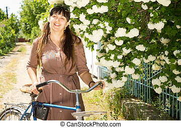 Smiling woman with her bicycle