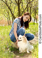 Smiling woman with her cute dog