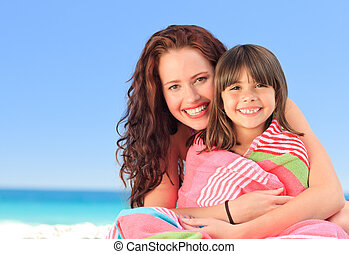 Smiling woman with her daughter in