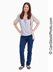 Smiling woman with her hands on her hip