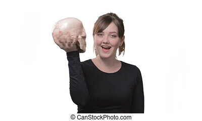 Smiling woman with human skull