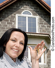 smiling woman with keys to the house