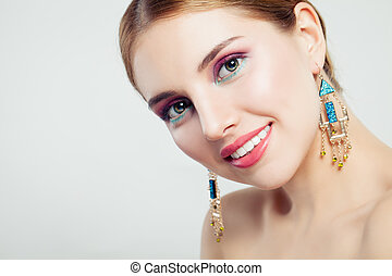 Smiling woman with makeup, portrait. Beautiful female face closeup