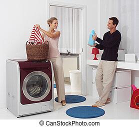 dooing  laundry with washing machine