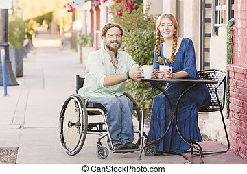 Smiling Woman with Man in Wheelchair