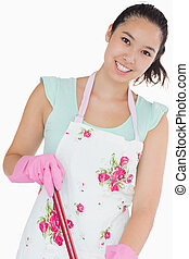 Smiling woman with mop
