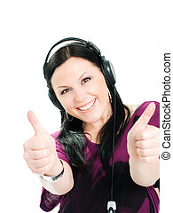 smiling woman with music headphones holding thumbs up
