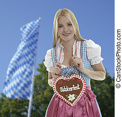 Smiling woman with Oktoberfest heart