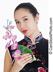 Smiling woman with orchid