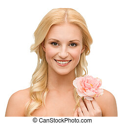 smiling woman with peony flower