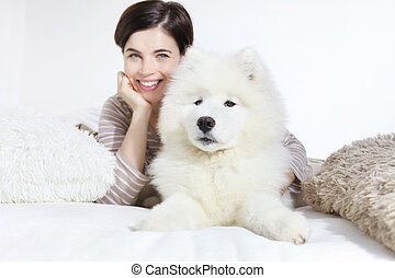 Smiling woman with pet dog