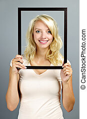 Smiling woman with picture frame
