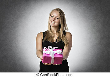 Smiling woman with present
