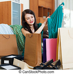 Smiling woman with purchases
