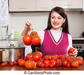 Smiling woman with red tomatoes