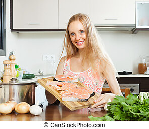 Smiling woman with salmon fish