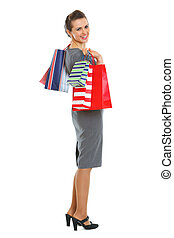 Smiling woman with shopping bags