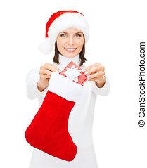 smiling woman with small giftbox and stocking - christmas,...