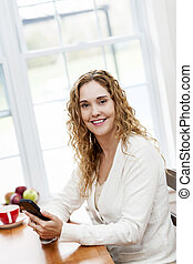 Smiling woman with smart phone
