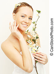 Smiling woman with spring apple flowers