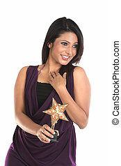 Smiling woman with star trophy