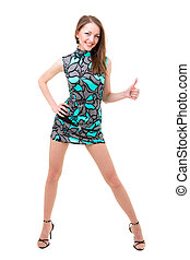 Smiling woman with thumbs up gesture posing